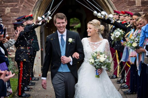 bride and groom leaving the thornbury church in gloucestershire
