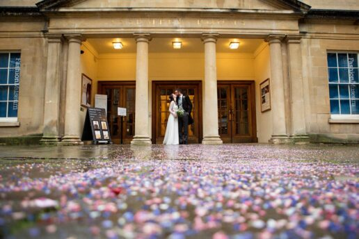 bride and groom in front of bath assembly rooms