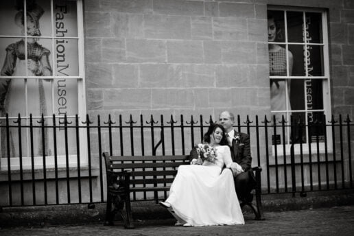 bride and groom in front of assembly rooms