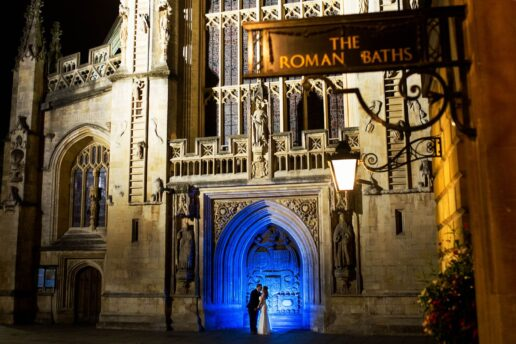 wedding couple in front of bath abbey at night