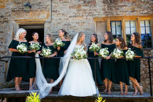 bride and their bridesmaids in front of bridal suite at brympton house