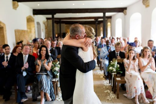 bride and groom hugging after the first kiss at coach house at brympton house