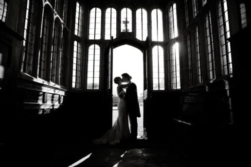 bride and groom silhouette by the main entrance to brympton house