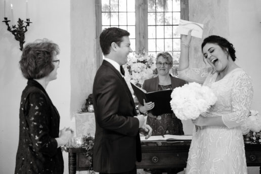 bride feeling happy after receiving their marriage certificate