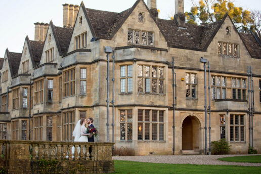 wedding couple in front of coombe lodge
