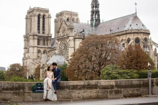 wedding couple with a paris notre damme cathedral in the background