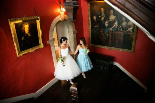 bride and bridesmaid in front of bridal suite at elmore court in gloucestershire