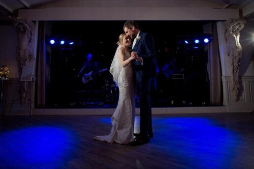 bride and groom dancing in the ballroom at manor by the lake