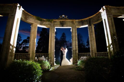 night shot of married couple at the belvedere at orchardleigh house