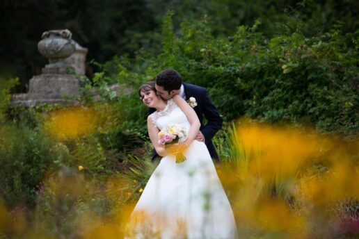 wedding couple kissing in orchardleigh garden