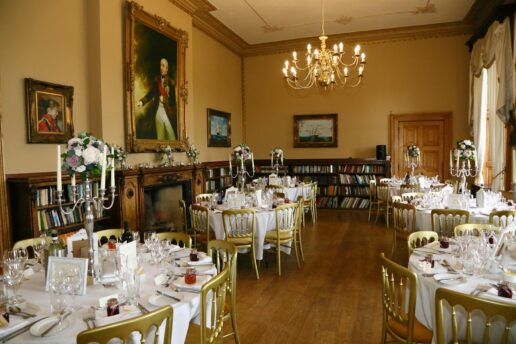 grand ballroom at orchardleigh house set up for wedding breakfast