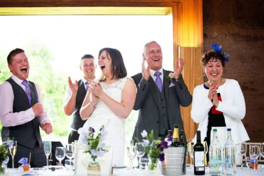 bride and groom laughing during speeches at gillyflower at elmore court