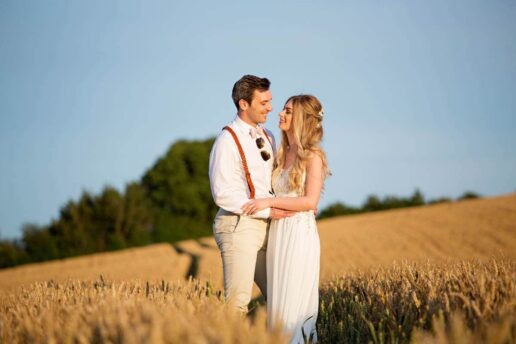 maried couple on the fields behind elmore court