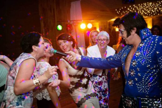 guests singing with elvis presley tribute at gillyflower at elmore court wedding