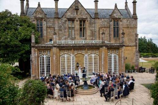 outdoor wedding ceremony at the sun terrace at dillington house in somerset