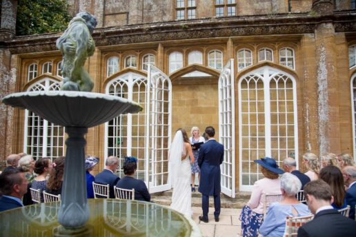 outdoor ceremony in front of the orangery at dillington house
