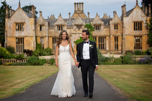 bride and groom walking in front of dillington house near iilminster