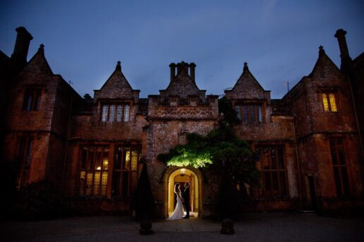 evening shot of the bride & groom in the entrance to dillington house in somerset