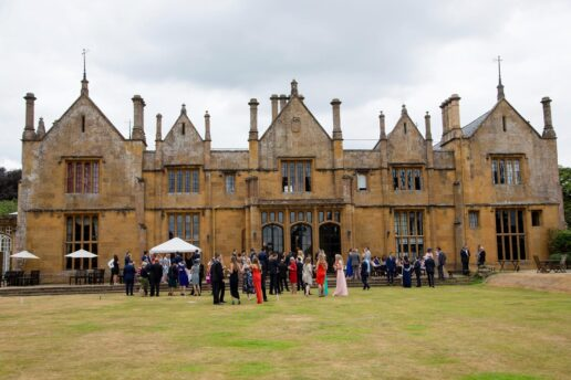 wedding guests during drinks reception at dillington house