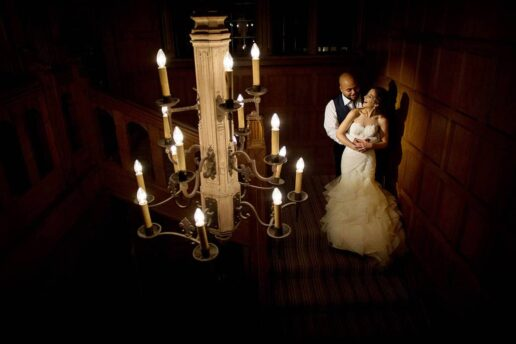 wedding couple embracing each other on the stairs inside the coombe lodge