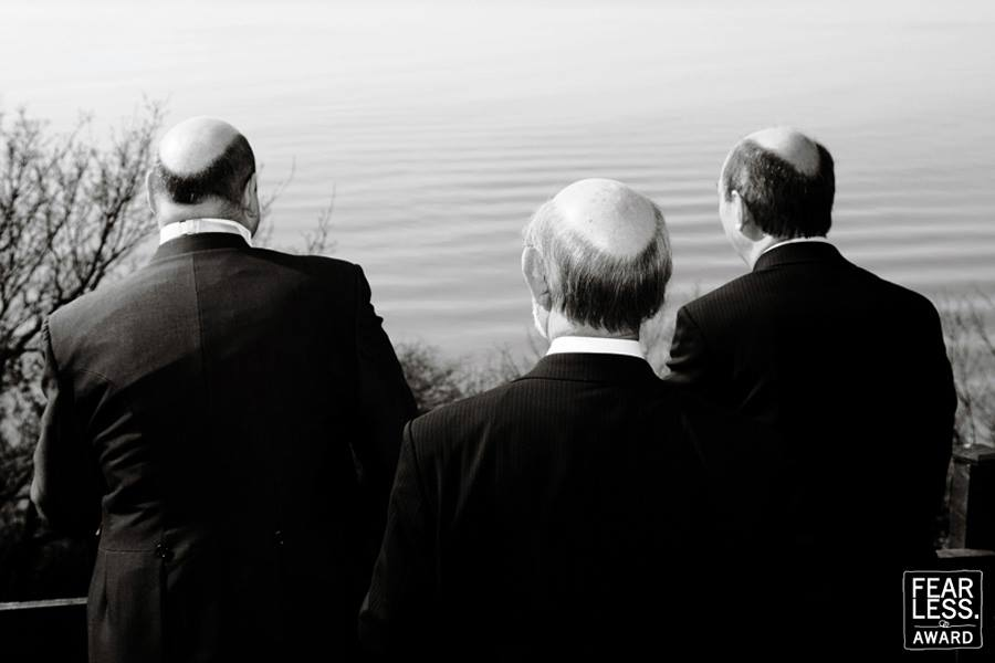 three bold men looking into the sea