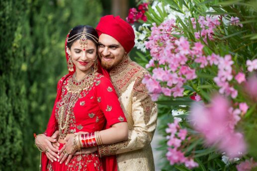 sikh wedding couple embracing in the park in bristol