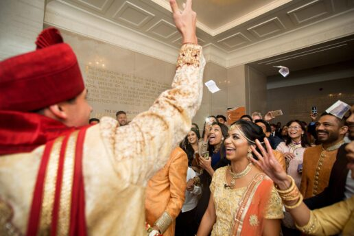 groom throwing money (dowry) to the brides family before the muslim ceremony