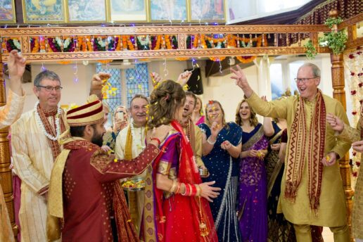 hindu wedding couple walking during wedding ceremony at bristol hindu temple
