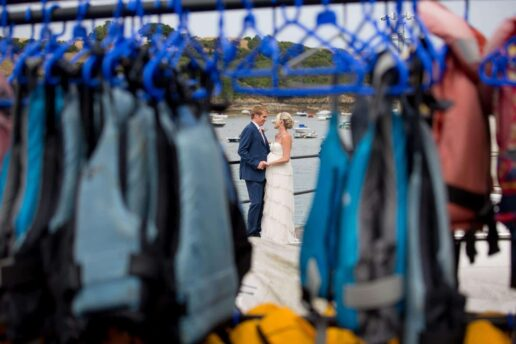 bride and groom at salcombe harbour in devon