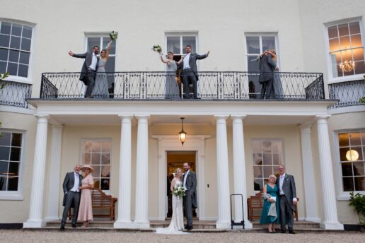bridal party in front of Rockbeare manor near Exeter