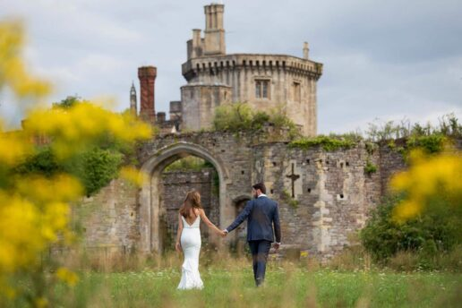 wedding couple walking towards Powderham castle in Exeter