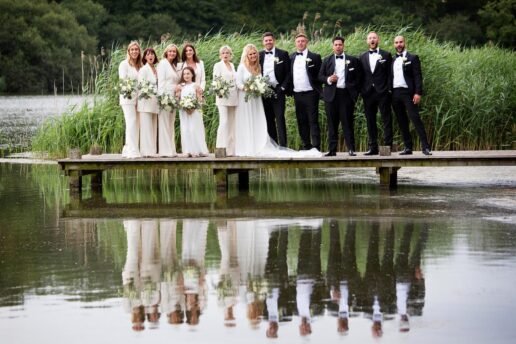 bridal party on the jetty at the serpentine lake next to hensol castle