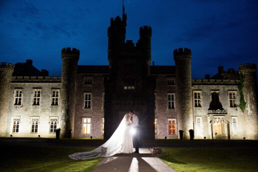 evening picture of the weding couple in front of hensol castle
