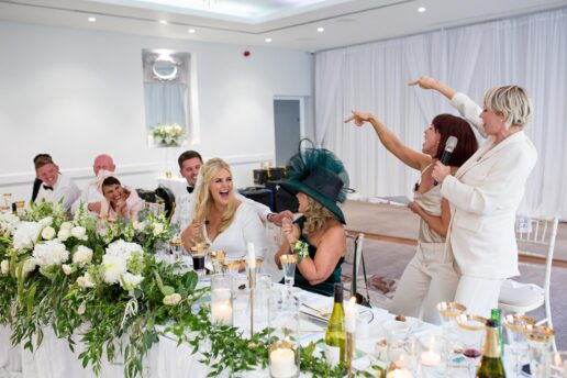 bridesmaids giving hilarious speech in courtyard hall at hensol castle