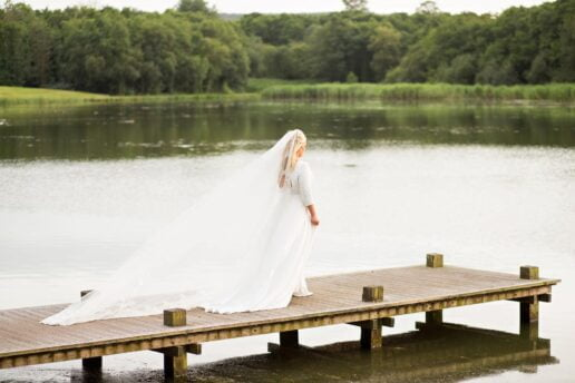 bride on the jetty on the serpentine lake next to hensol castle