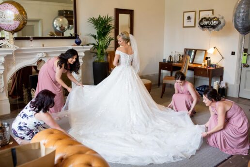 bride getting ready with bridesmaids at bridal suite at de vere tortworth court