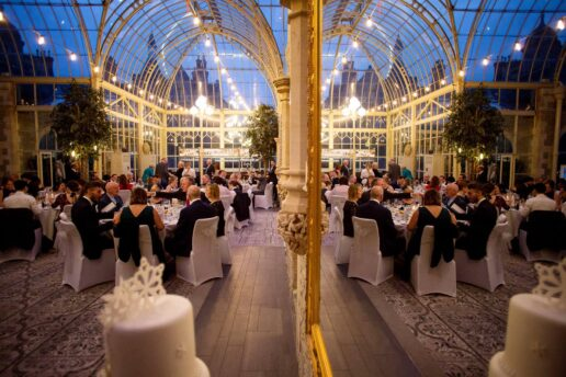 orangery at tortworth court with sitting wedding guests
