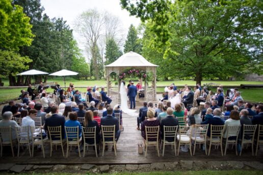 outdoor wedding ceremony at the pergola at eastington park
