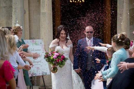 confetti shot of bride and groom in front of eastington park