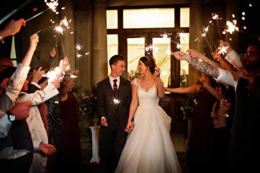 sparklers send off of wedding couple in front of entrance to eastington park