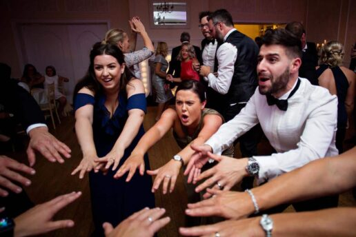 wedding guests dancing in the circle in the ballroom at eastington park