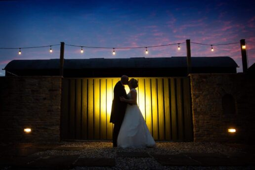 backlit portrait of wedding couple at winkworth farm