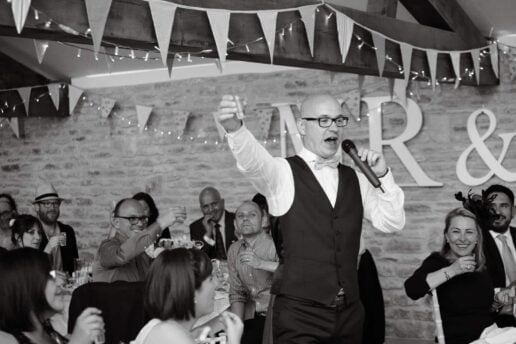 groom giving a toast at The Threshing Barn in Winkworth farm
