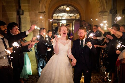 bride and groom holding sparklers surrounded by the guests with sparklers at coombe lodge in blagdon