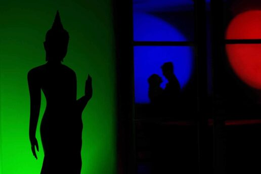 silhouette of budda and wedding couple at matar center in gloucestershire