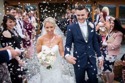 confetti shot of wedding couple at quantock lakes wedding venue