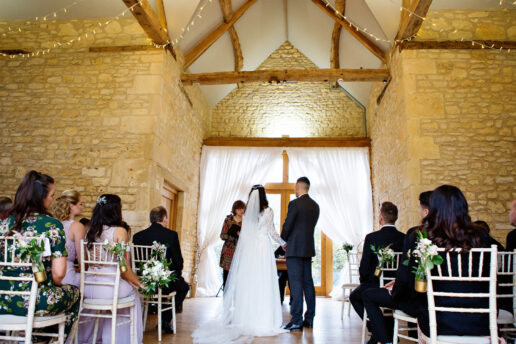 wedding ceremony at The Cotswold Threshing Barn at the barn at upcote