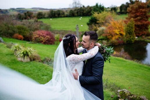 wedding couple hugging each other in the secret garden at the barn at upcote in cotswolds