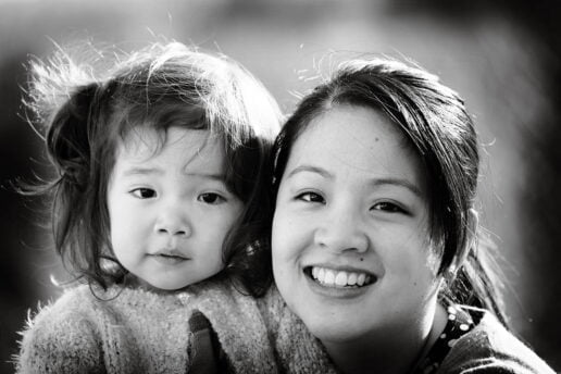black an white image of Chinese woman and her little daughter