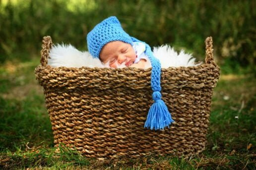 newborn in the basket with a cute hat